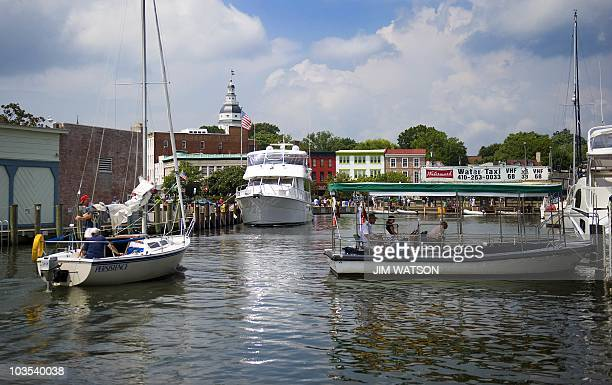 A sailboat pulls into the Annapolis Harbor in the middle of downtown Annapolis MD August 22 2010 Annapolis was settled in 1649 and from 1783 to...