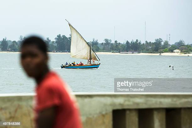A sailboat rides along the beach in Maputo on November 19 2015 in Maputo Mozambique