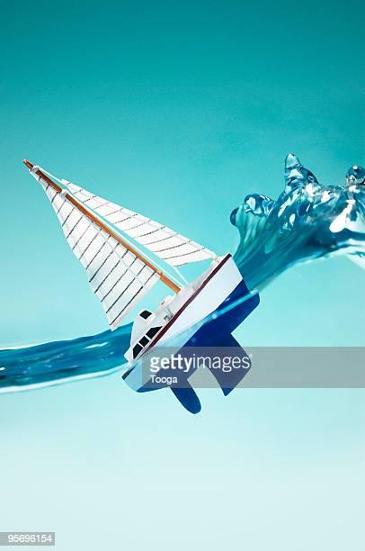 Sailboat riding wave