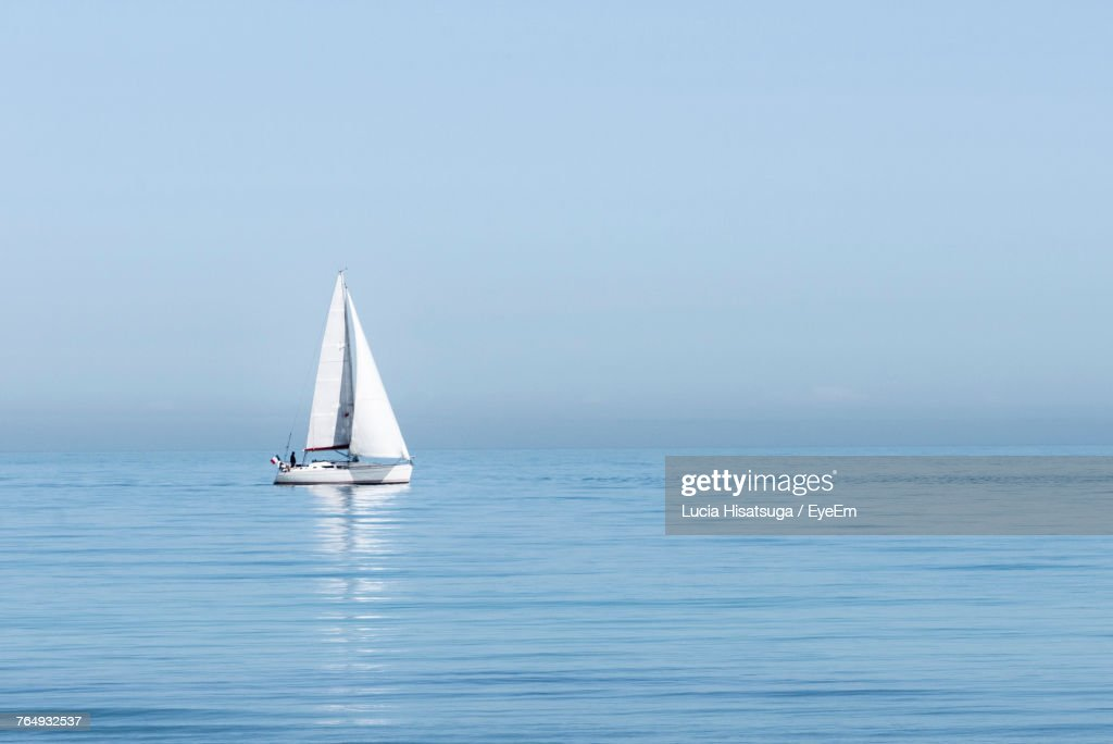 Sailboat Sailing In Sea Against Clear Sky : Stock Photo