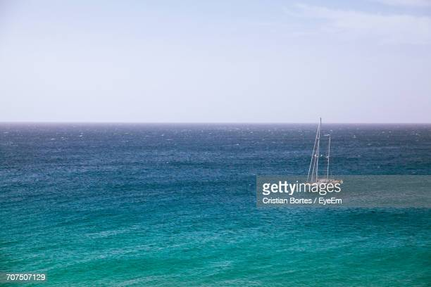 sailboat sailing in sea against sky - bortes stock photos and pictures