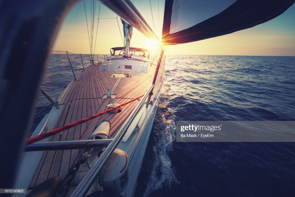 Sailboat Sailing In Sea During Sunset : Stock Photo