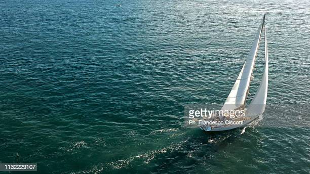 sailboat sailing on emerald sea - sailor stock pictures, royalty-free photos & images
