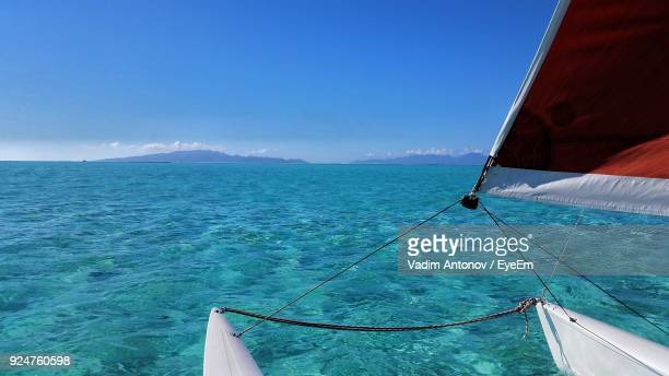 sailboat sailing on sea against blue sky - antonov stock pictures, royalty-free photos & images