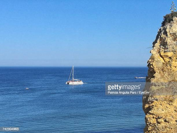 Sailboat Sailing On Sea Against Clear Blue Sky