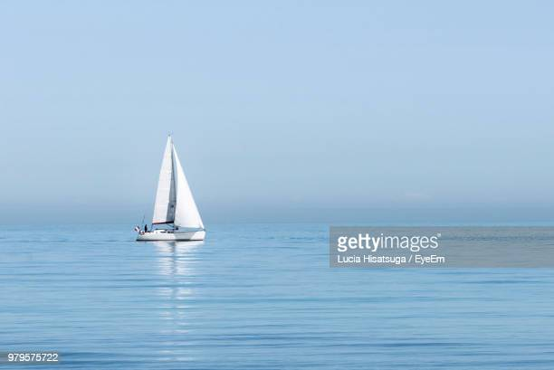 sailboat sailing on sea against clear sky - sailing stock pictures, royalty-free photos & images