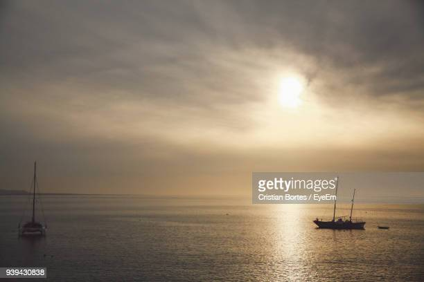 sailboat sailing on sea against sky during sunset - bortes stock photos and pictures