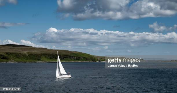 sailboat sailing on sea against sky - sailor stock pictures, royalty-free photos & images