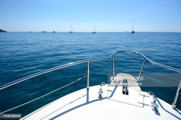 sailboat sailing on sea against sky - yachting stock pictures, royalty-free photos & images
