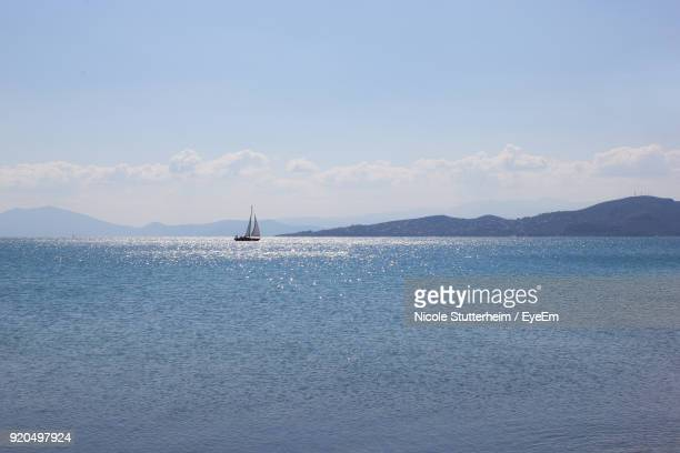 sailboat sailing on sea against sky - stutterheim stock pictures, royalty-free photos & images