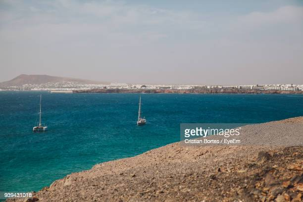 sailboat sailing on sea against sky - bortes stock photos and pictures