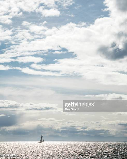 sailboat sailing on sea, vancouver, british columbia, canada - distant stock pictures, royalty-free photos & images