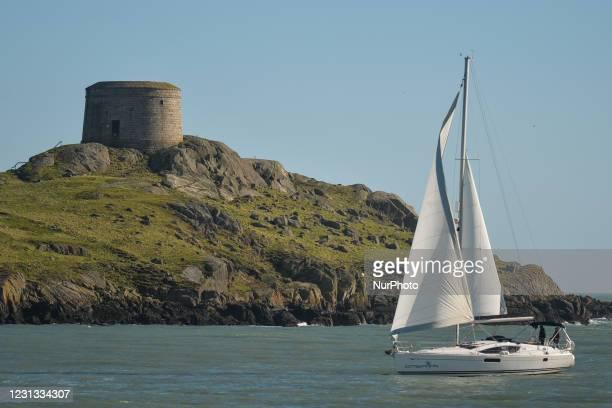 Sailboat seen in the sea near Dalkey Island, a suburb of Dublin, during Level 5 Covid-19 lockdown. On Monday, February 22 in Dalkey, Dublin, Ireland.