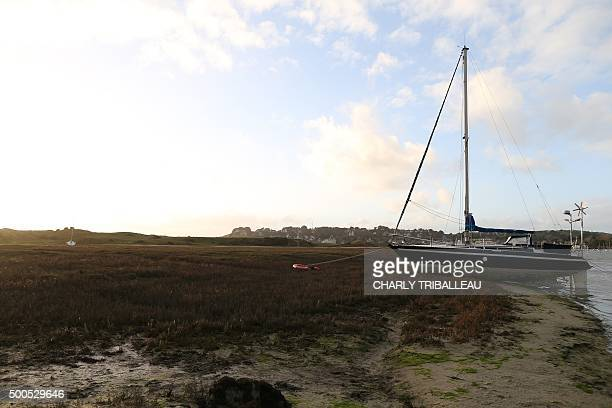A sailboat sits moored on the shoreline in BarnevilleCarteret northwestern France on December 8 2015 / AFP / CHARLY TRIBALLEAU