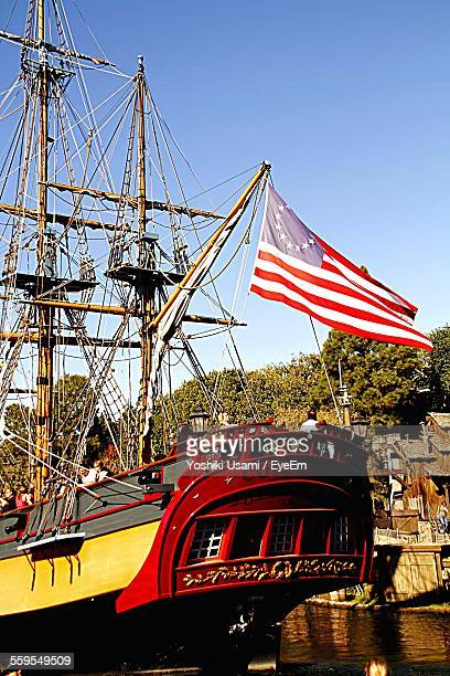 Sailboat With Betsy Ross Flag Moored Against Blue Sky