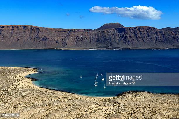 Sailboats anchored at Los Franceses beach, La Graciosa, Canary Islands