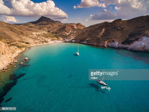 Sailboats anchored in bay at Milos island