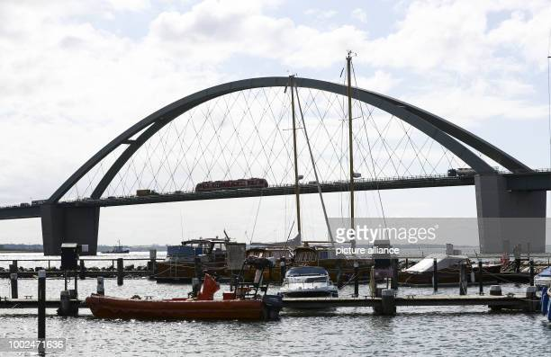 Sailboats and motorboats anchored in Fehmarn Sound harbour in front of the Fehmarn Sound Bridge off Fehmarn island Germany 08 May 2017 Under contract...