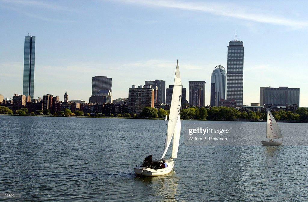 Sailboats are seen on the Charles River with the boston skyline line in the backround October 10, 2003 in Boston, Massachusetts. The Hancock Tower is on the far Lefthand side.