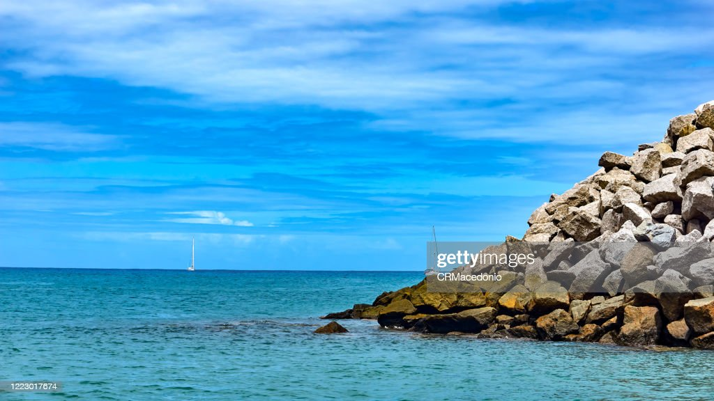 Sailboats arriving at the reef of the Bay of Santo Antonio. : Stock Photo