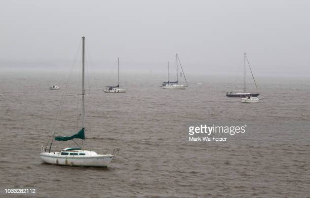 Sailboats at anchor during Hurricane Florence in the middle of the Great Pee Dee River on September 14 2018 in Georgetown South Carolina Hurricane...