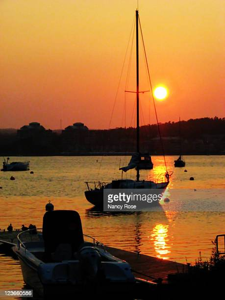 sailboats at sunset - bedford nova scotia stock pictures, royalty-free photos & images