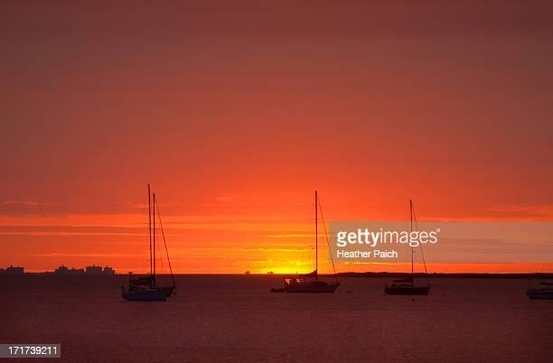 Sailboats basking in the sunrise on Raritan Bay in New Jersey.