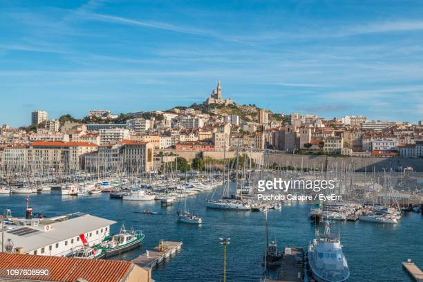 sailboats in city at waterfront - bouches du rhone stock pictures, royalty-free photos & images