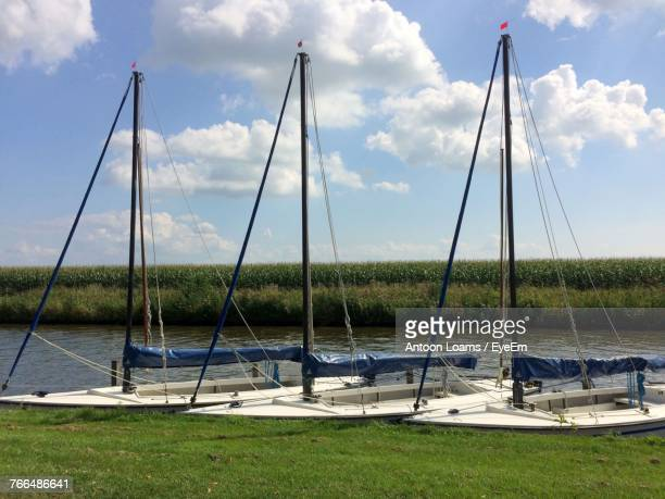 Sailboats In Grass Against Sky