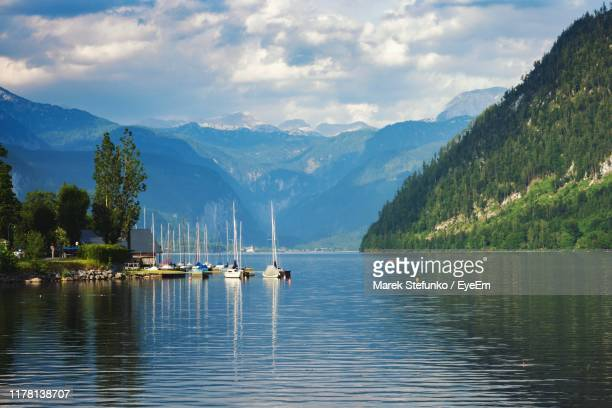 sailboats in lake against sky - marek stefunko stock photos and pictures