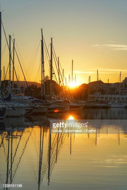 sailboats in marina at sunset - denia stock pictures, royalty-free photos & images