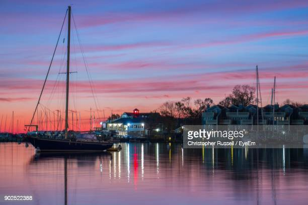 sailboats in sea at sunset - annapolis stock pictures, royalty-free photos & images