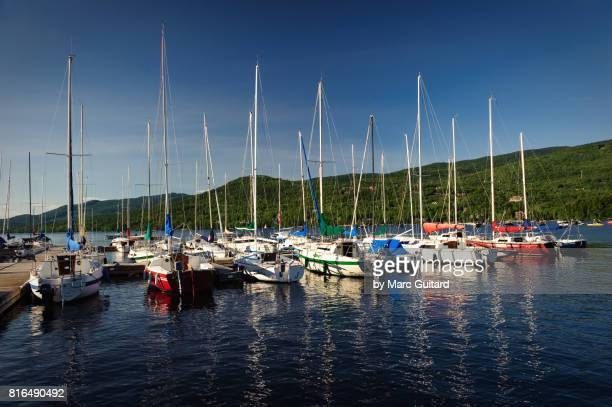 sailboats, mont tremblant, quebec, canada - mont tremblant stock pictures, royalty-free photos & images