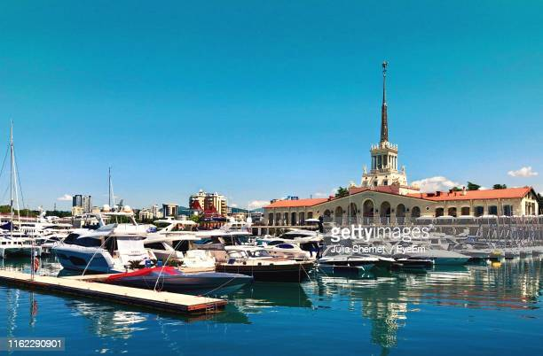 sailboats moored at harbor against clear blue sky - sochi stock pictures, royalty-free photos & images
