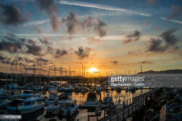 sailboats moored at harbor during sunset - coffs harbour stock pictures, royalty-free photos & images