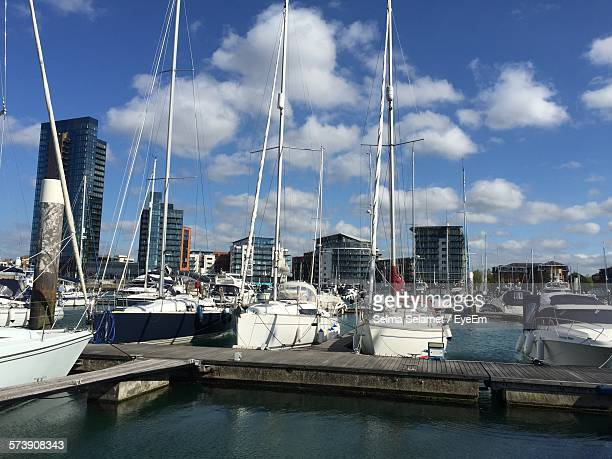 sailboats moored at harbor in city - southampton england stock pictures, royalty-free photos & images