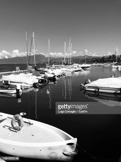 sailboats moored at harbor - consiglio stock pictures, royalty-free photos & images