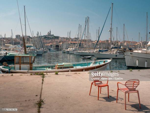 sailboats moored at harbor - bouches du rhone stock pictures, royalty-free photos & images