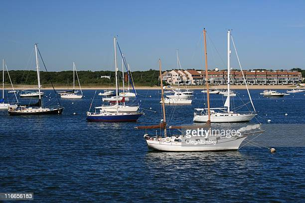 sailboats moored at hyannis harbor, cape cod, massachisetts. blue sky. - hyannis port stock pictures, royalty-free photos & images