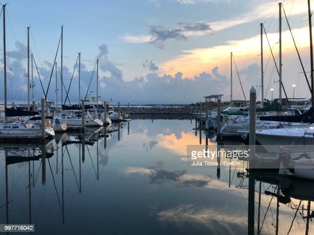 sailboats moored in harbor at sunset - marina stock pictures, royalty-free photos & images