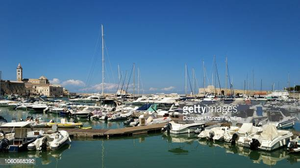 sailboats moored in harbor - marica octavian stock photos and pictures
