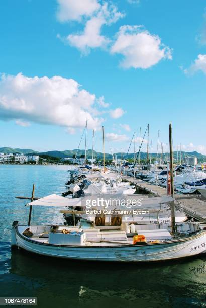 sailboats moored in harbor - insel ibiza stock-fotos und bilder
