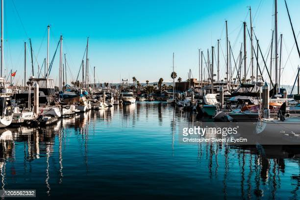 sailboats moored in harbor - redondo beach california stock pictures, royalty-free photos & images