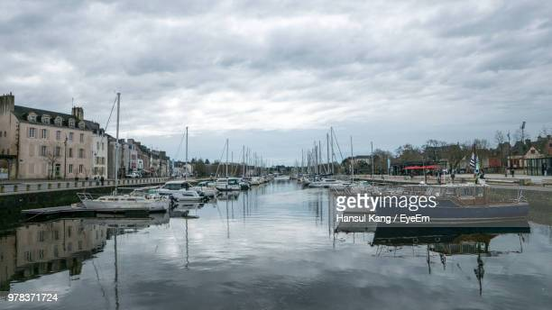 sailboats moored in harbor - ヴァンヌ ストックフォトと画像