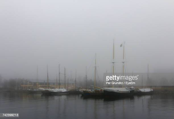 sailboats moored in lake against sky - per grunditz stock pictures, royalty-free photos & images