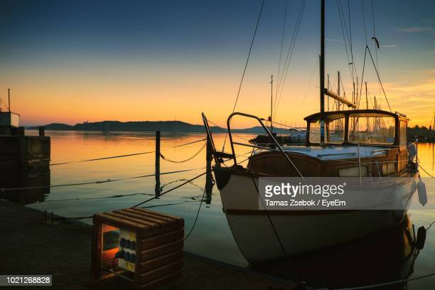 sailboats moored in marina at sunset - moored stock pictures, royalty-free photos & images