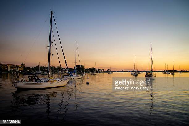 sailboats moored in river against sunset, stuart florida - stuart florida stock pictures, royalty-free photos & images
