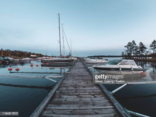 sailboats moored in sea against clear sky - colbing stock pictures, royalty-free photos & images