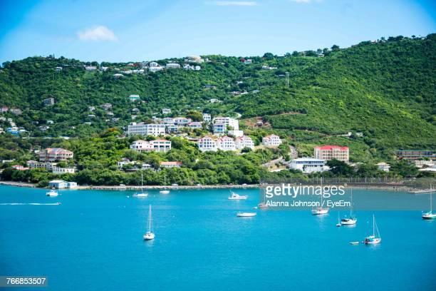 sailboats moored in sea against sky - jamaica stock pictures, royalty-free photos & images