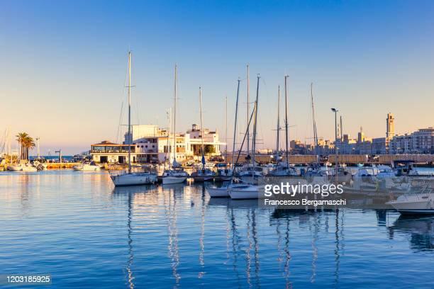 sailboats moored in the turistic port of bari - italia stockfoto's en -beelden
